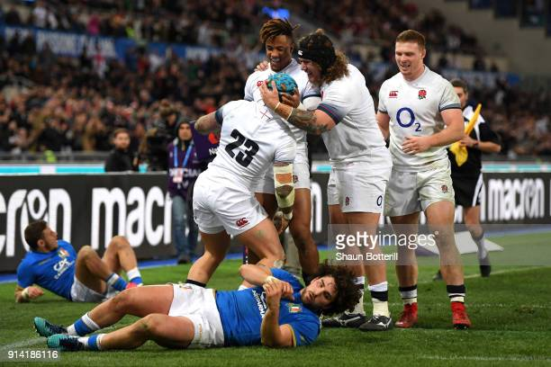 Jack Nowell of England celebrates scoring his sides seventh try with his team mates during the NatWest Six Nations round One match between Italy and...
