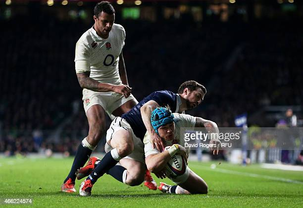 Jack Nowell of England dives over to score his team's third try of the game during the RBS Six Nations match between England and Scotland at...