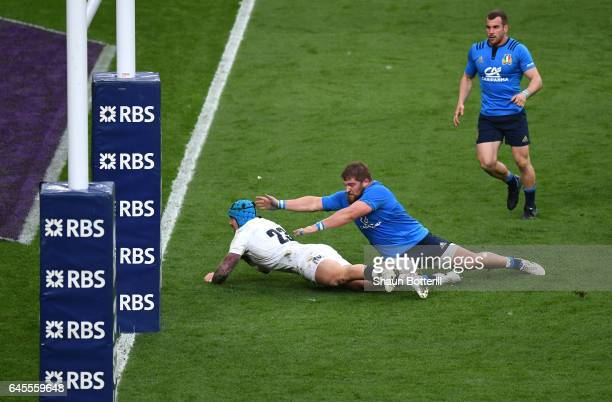 Jack Nowell of England goes over to score his second try during the RBS Six Nations match between England and Italy at Twickenham Stadium on February...