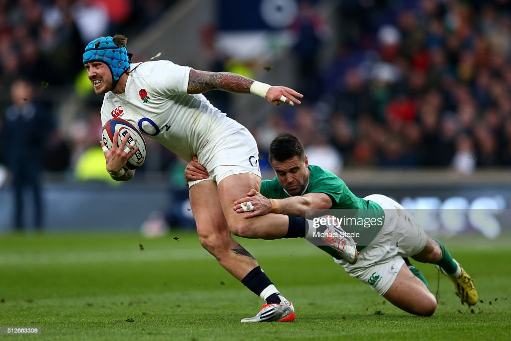 Jack Nowell of England is tackled by Conor Murray of Ireland during the RBS Six Nations match between England and Ireland at Twickenham Stadium on February 27, 2016 in London, England.