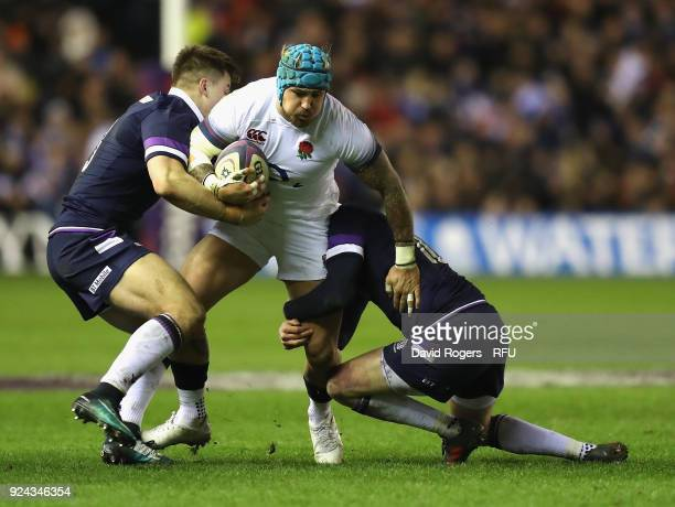 Jack Nowell of England is tackled by Finn Russell and Huw Jones during the NatWest Six Nations match between Scotland and England at Murrayfield on...