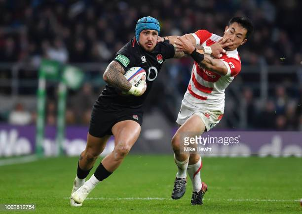 Jack Nowell of England is tackled by Kenki Fukuoka of Japan during the Quilter International match between England and Japan at Twickenham Stadium on...