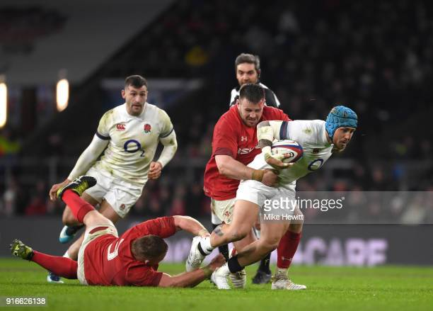 Jack Nowell of England is tackled by Samson Lee of Wales and Rob Evans of Wales during the NatWest Six Nations round two match between England and...