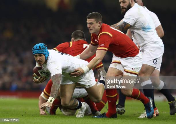 Jack Nowell of England is tackled by Scott Williams of Wales during the RBS Six Nations match between Wales and England at the Principality Stadium...