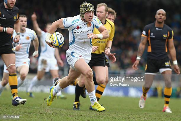 Jack Nowell of Exeter breaks clear to score a try during the Aviva Premiership match between London Wasps and Exeter Chiefs at Adams Park on April...