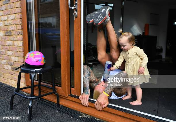 Jack Nowell of Exeter Chiefs and England receives a drink from his daughter Nori while he exercises at home during the Coronavirus Lockdown on May...