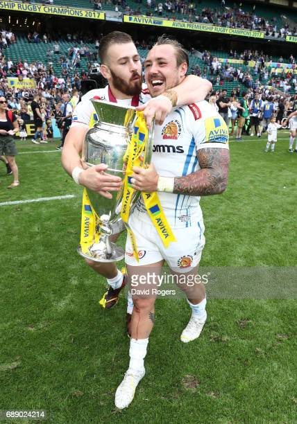 Jack Nowell of Exeter Chiefs and Luke CowanDickie of Exeter Chiefs celebrate with The Aviva Premiership trophy after the Aviva Premiership Final...