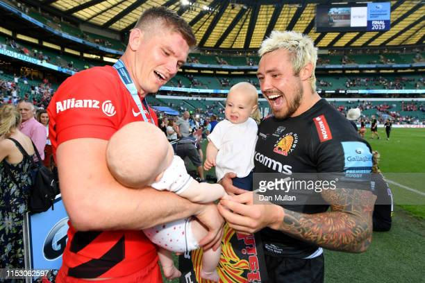 Jack Nowell of Exeter Chiefs and Owen Farrell of Saracens enjoy a moment with their children together following the Gallagher Premiership Rugby Final...