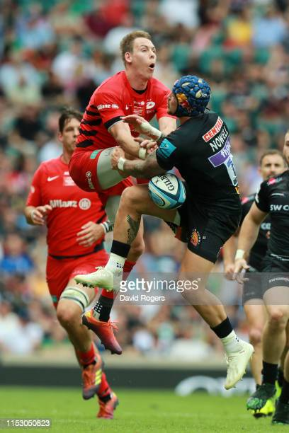 Jack Nowell of Exeter Chiefs battles for possession with Liam Williams of Saracens during the Gallagher Premiership Rugby Final between Exeter Chiefs...