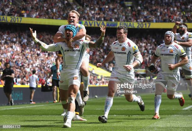 Jack Nowell of Exeter Chiefs celebrates scoring his sides first try with his Exeter Chiefs team mates during the Aviva Premiership Final between...