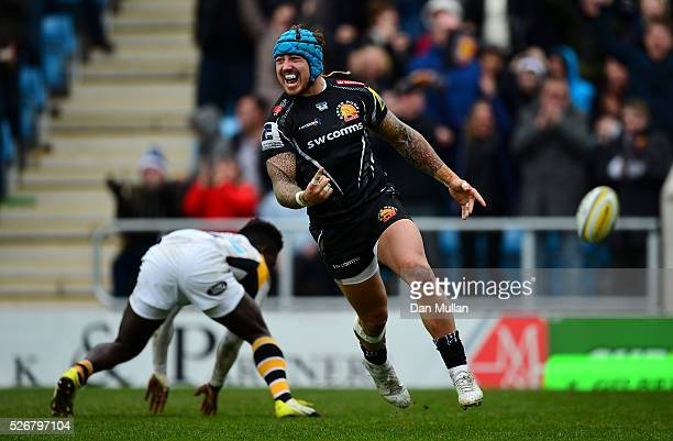 Jack Nowell of Exeter Chiefs celebrates scoring his side's third try past Christian Wade of Wasps during the Aviva Premiership match between Exeter...