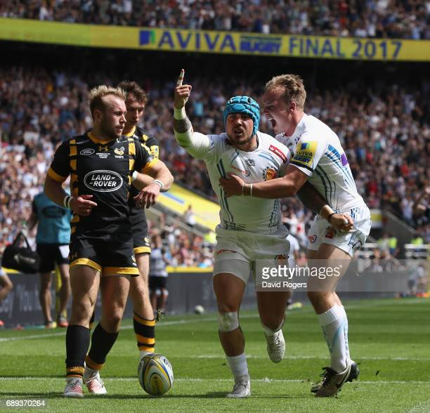 Jack Nowell of Exeter Chiefs celebrates with team mate Stuart Townsend during the Aviva Premiership match between Wasps and Exeter Chiefs at...