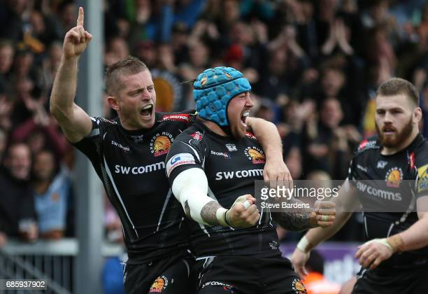 Jack Nowell of Exeter Chiefs celebrates with teammate Gareth Steenson after scoring the opening try during the Aviva Premiership semi final match...