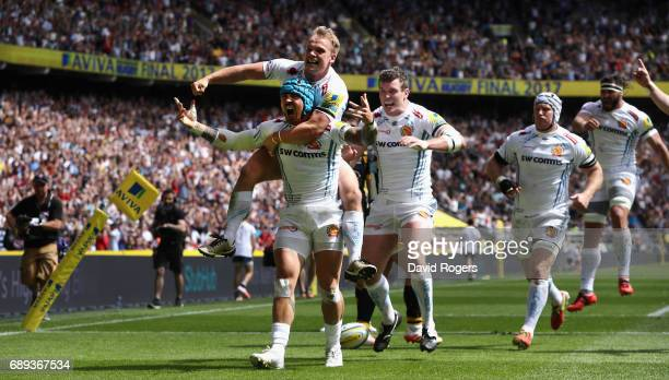 Jack Nowell of Exeter Chiefs celerbates with team mate Stuart Townsend during the Aviva Premiership match between Wasps and Exeter Chiefs at...