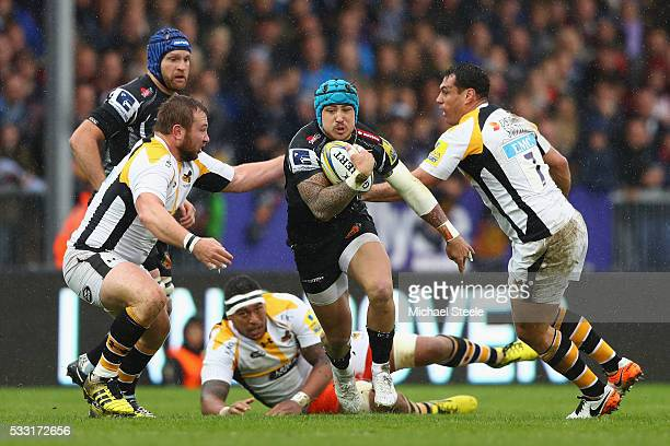 Jack Nowell of Exeter Chiefs cuts between Matt Mullan and George Smith of Wasps during the Aviva Premiership semi final match between Exeter Chiefs...