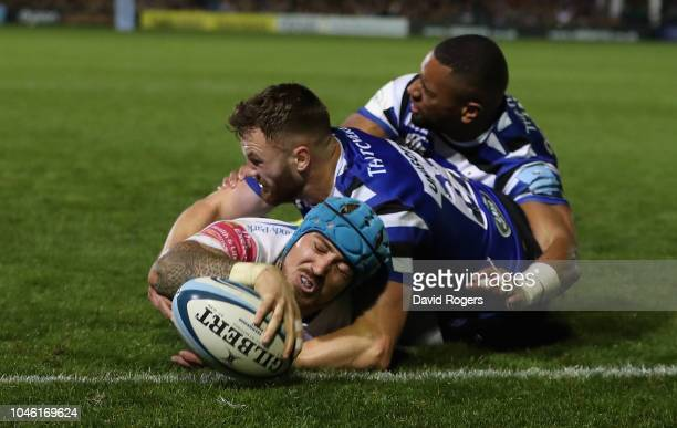 Jack Nowell of Exeter Chiefs dives over for their fifth try despite being held by Max Wright and Joe Cokanasiga during the Gallagher Premiership...