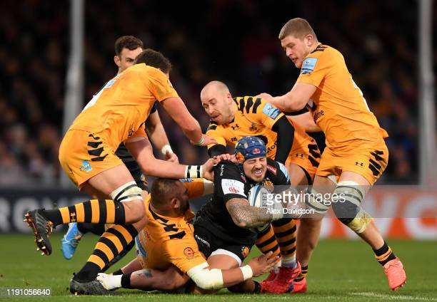 Jack Nowell of Exeter Chiefs is is tackled by Will Rowlands Jack Willis Zurabi Zhvania and Dan Robson of Wasps during the Gallagher Premiership Rugby...