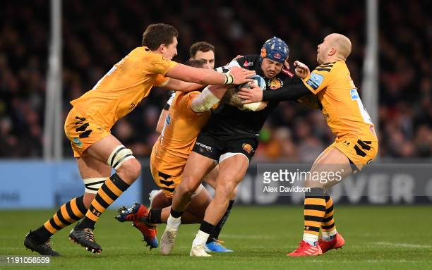Jack Nowell of Exeter Chiefs is is tackled by Will Rowlands, Zurabi Zhvania and Dan Robson of Wasps during the Gallagher Premiership Rugby match...