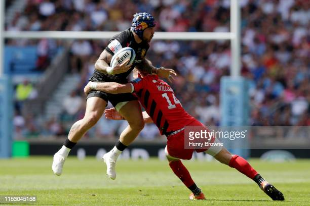 Jack Nowell of Exeter Chiefs is tackled by Liam Williams of Saracens during the Gallagher Premiership Rugby Final between Exeter Chiefs and Saracens...