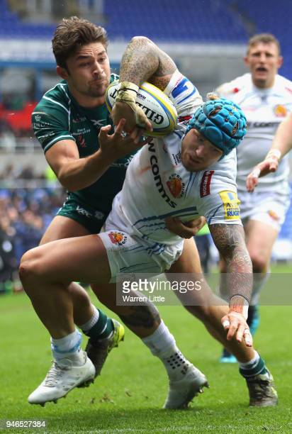Jack Nowell of Exeter Chiefs is tackled by Tom Fowlie of London Irish during the Aviva Premiership match between London Irish and Exeter Chiefs at...