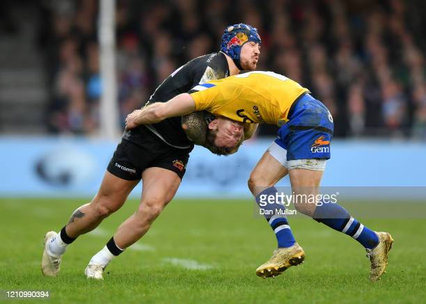 Jack Nowell of Exeter Chiefs is tackled by Will Chudley of Bath during the Gallagher Premiership Rugby match between Exeter Chiefs and Bath Rugby at...
