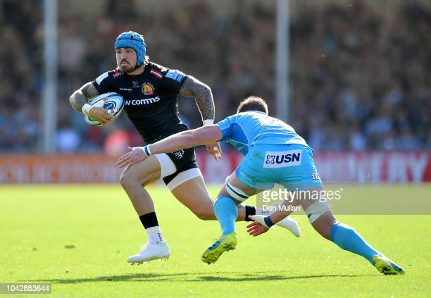 Jack Nowell of Exeter Chiefs makes a break past GJ van Velze of Worcester Warriors during the Gallagher Premiership Rugby match between Exeter Chiefs...