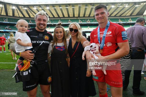 Jack Nowell of Exeter Chiefs poses with his girlfriend Zoe Pearce and their daughter Nori alongside Owen Farrell and his wife Georgie and their son...