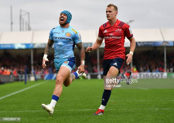 Jack Nowell of Exeter Chiefs reacts after a cross field kick goes dead under pressure from Mike Haley of Munster during the Heineken Champions Cup...