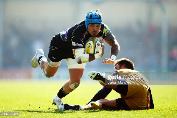 Jack Nowell of Exeter is tackled by Gavin Henson of Bristol during the Aviva Premiership match between Exeter Chiefs and Bristol Rugby at Sandy Park...