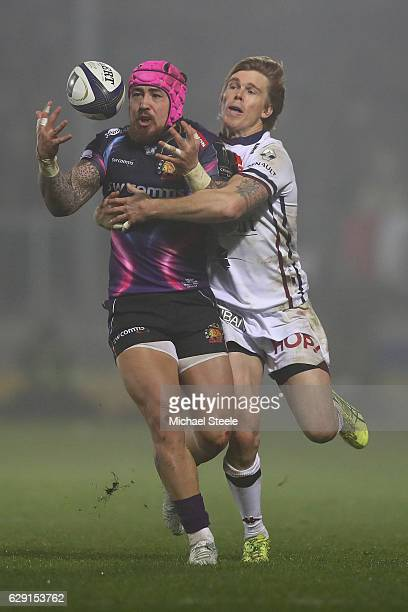 Jack Nowell of Exeter loses the ball under pressure from Blair Connor of Bordeaux during the European Rugby Challenge Cup Pool 5 match between Exeter...