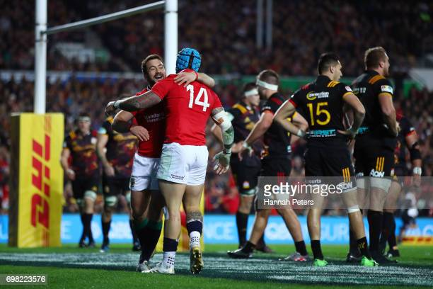 Jack Nowell of the Lions is congratulated by teammate Greig Laidlaw of the Lions after scoring their team's opening try during the 2017 British Irish...