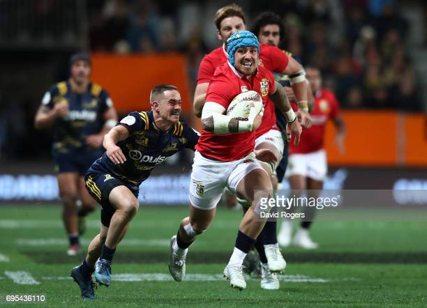 Jack Nowell of the Lions is tackled by Kayne Hammington of the Highlanders during the 2017 British Irish Lions tour match between the Highlanders and...