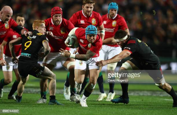 Jack Nowell of the Lions is tackled by Lachlan Boshier of the Chiefs during the 2017 British Irish Lions tour match between the Chiefs and the...