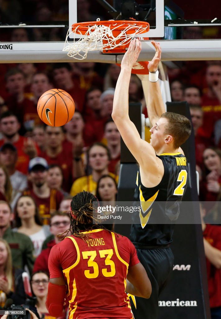 Jack Nunge #2 of the Iowa Hawkeyes dunks the ball as Solomon Young #33 of the Iowa State Cyclones defends in the first half of play at Hilton Coliseum on December 7, 2017 in Ames, Iowa.