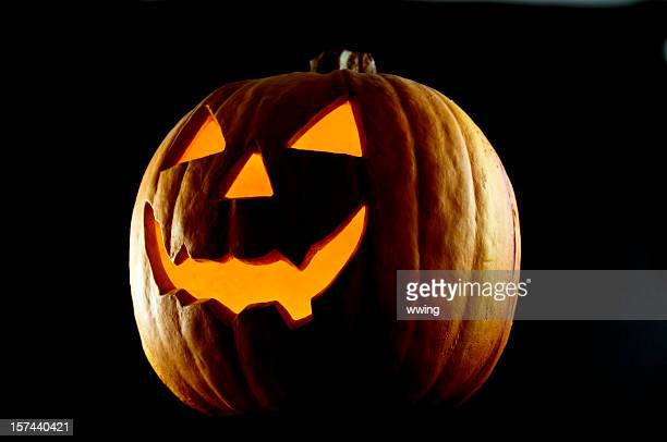 jack o' lantern at night - halloween lantern stock photos and pictures
