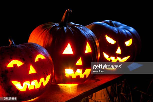 jack o' lantern in moonlight - ugly pumpkins stock photos and pictures