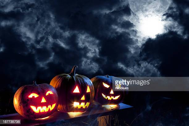 jack o' lantern in moonlight - jack o' lantern stock photos and pictures