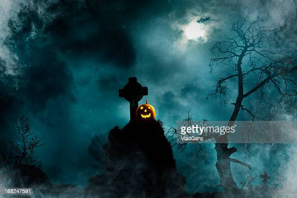 jack o' lantern in old cemetery - rest in peace stock photos and pictures