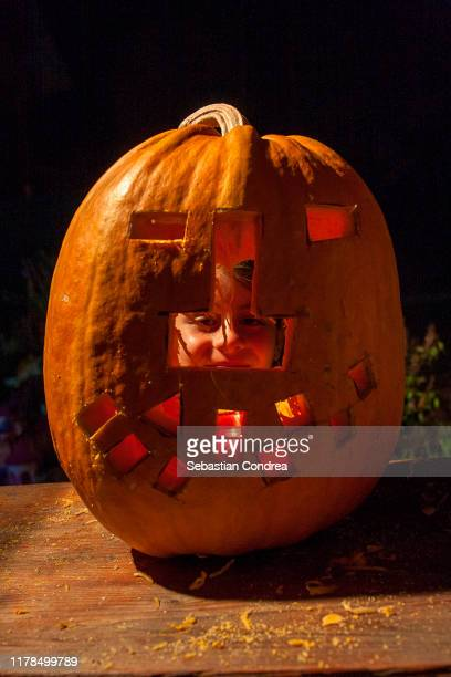 jack o lantern on human face, halloween - ugly pumpkins stock photos and pictures