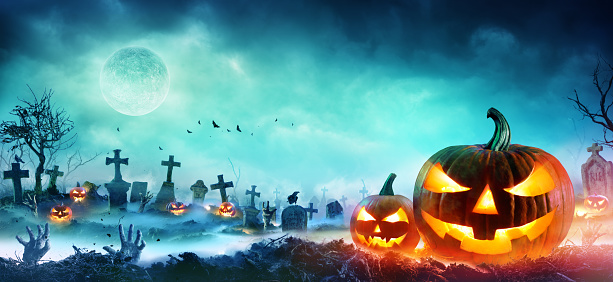 Jack O' Lanterns And Zombie Hands Rising Out Of A Graveyard In Misty Night 1032548124
