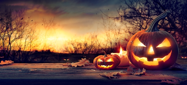 Jack O' Lanterns In Spooky Forest With Ghost Lights - Halloween Background 1173594824