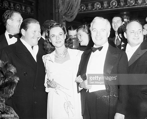 Jack Oakie Paulette Goddard and Charles Chaplin stars of the Chaplindirected film The Great Dictator at the film's opening held at the Capitol...