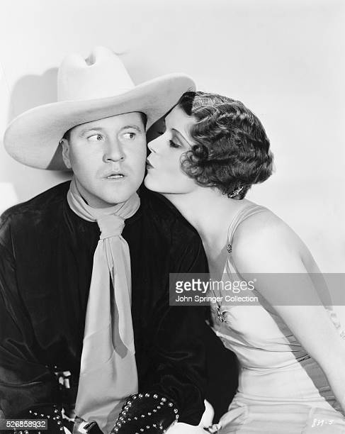 Jack Oakie receives a kiss on the cheek from June Collyer in the 1931 comedic western Dude Ranch