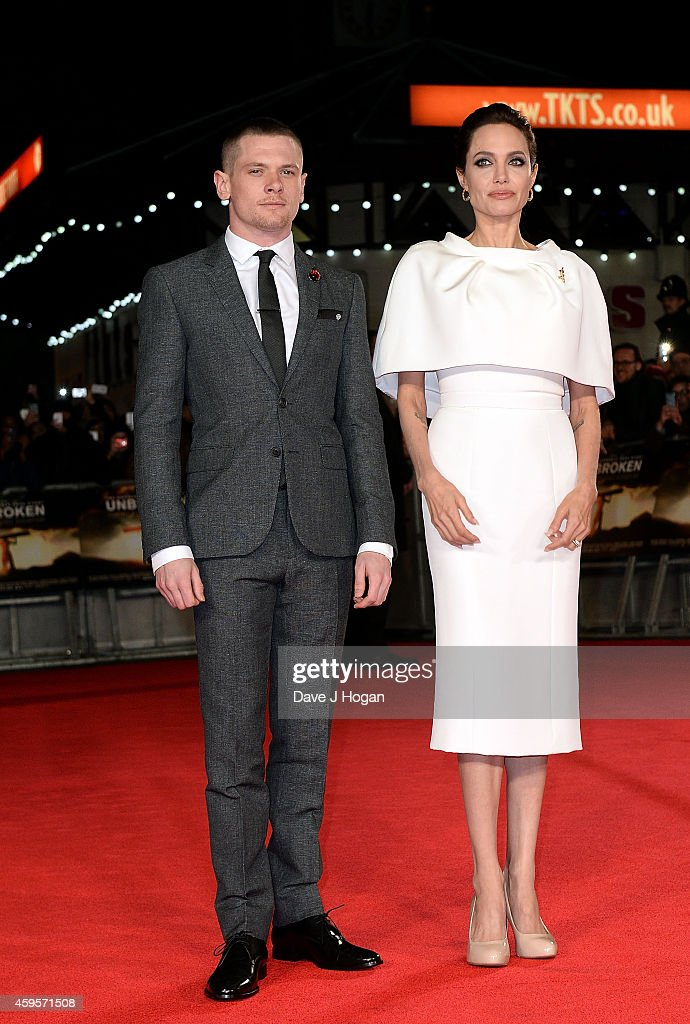 Jack O'Connell and Angelina Jolie attend the UK Premiere of 'Unbroken' at Odeon Leicester Square on November 25, 2014 in London, England.