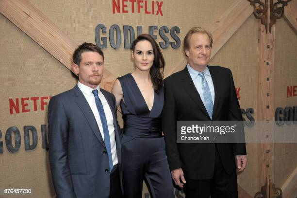 Jack O'Connell Michelle Dockery and Jeff Daniels attend 'Godless' New York premiere at The Metrograph on November 19 2017 in New York City
