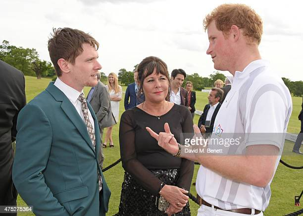 Jack O'Connell mother Alison O'Connell and Prince Harry attend day one of the Audi Polo Challenge at Coworth Park on May 30 2015 in London England