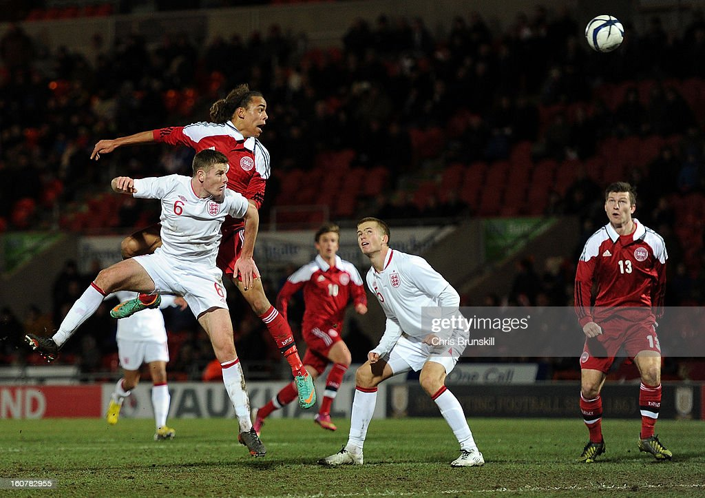 Jack O'Connell of England U19 jumps for a header with Yusuf Yurary of Denmark U19 during the International Match between England U19 and Denmark U19 at Keepmoat Stadium on February 5, 2013 in Doncaster, England.
