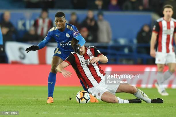 Jack O'Connell of Sheffield United goes down under a challenge from Kelechi Iheanacho of Leicester City during the FA Cup Fifth round match between...