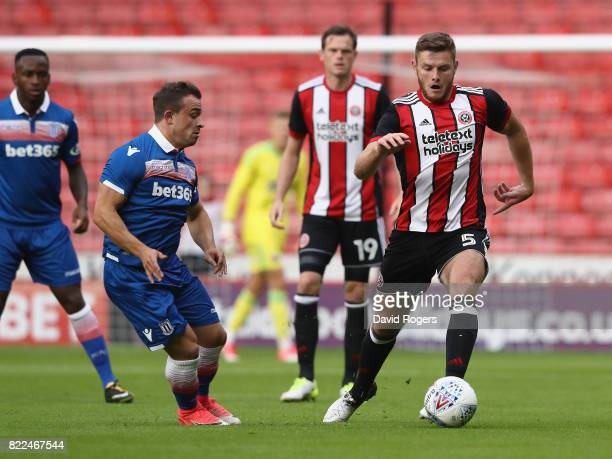 Jack O'Connell of Sheffield United moves away with the ball during the pre season friendly match between Sheffield United and Stoke City at Bramall...