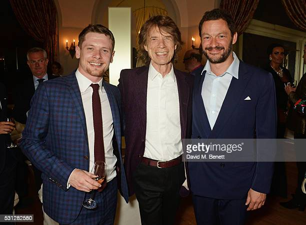Jack O'Connell Sir Mick Jagger and Dominic West attend The 8th Annual Filmmakers Dinner hosted by Charles Finch and JaegerLeCoultre at Hotel du...